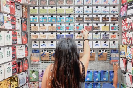 A-young-millennial-woman-shopping-for-the-right-gift-card-gift-and-present-at-the-store 92west
